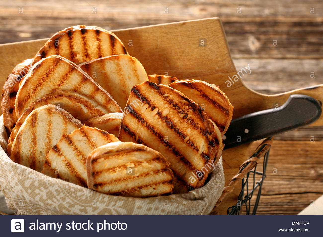 Fresh toast in basket on wooden background Stock Photo 178439542 1300x956