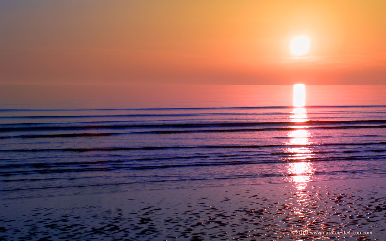 Desktop backgrounds of a sunset over gentle ocean at Walney Island 1280x800
