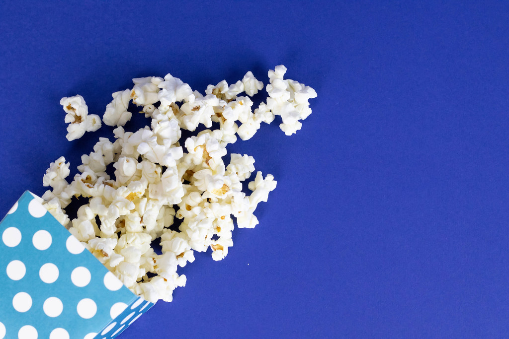 Popcorn on blue background Marco Verch is a Professional 1024x683