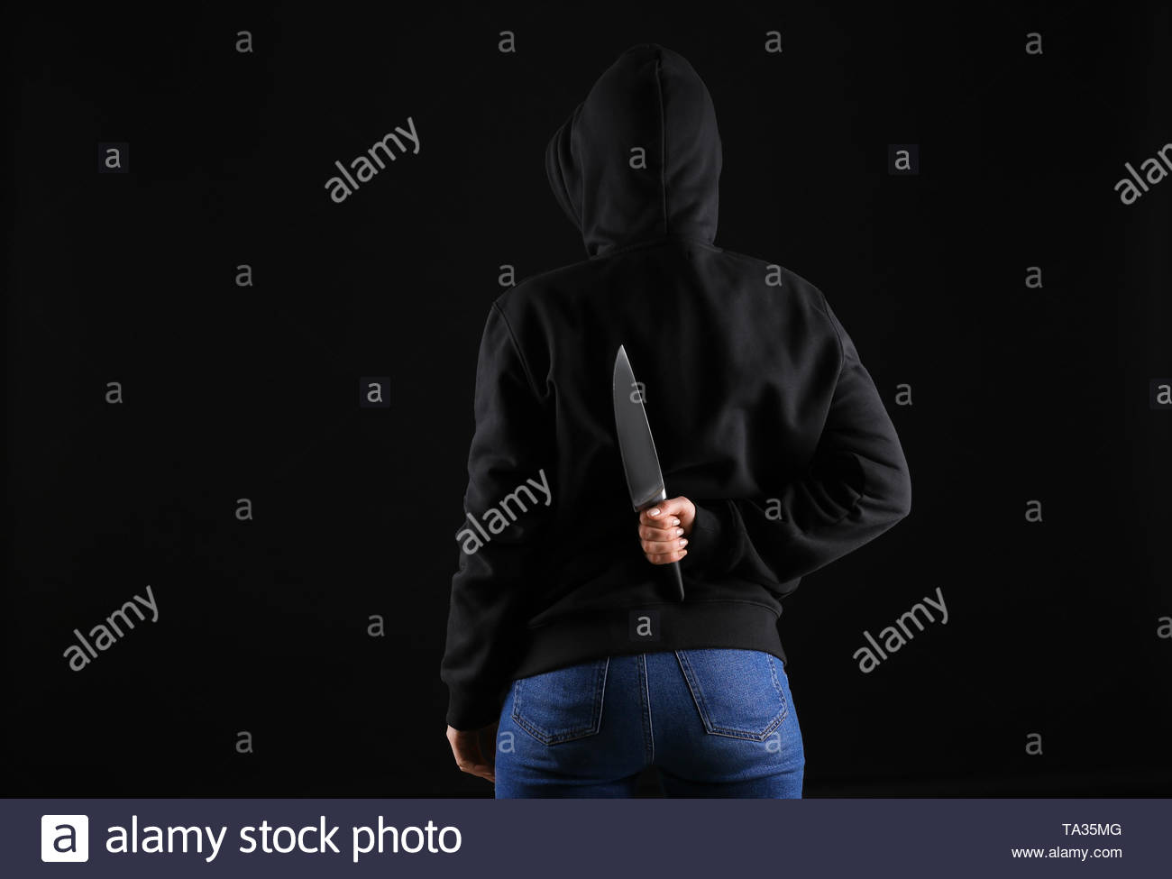 Bandit with knife on dark background Stock Photo 247162064   Alamy 1300x975