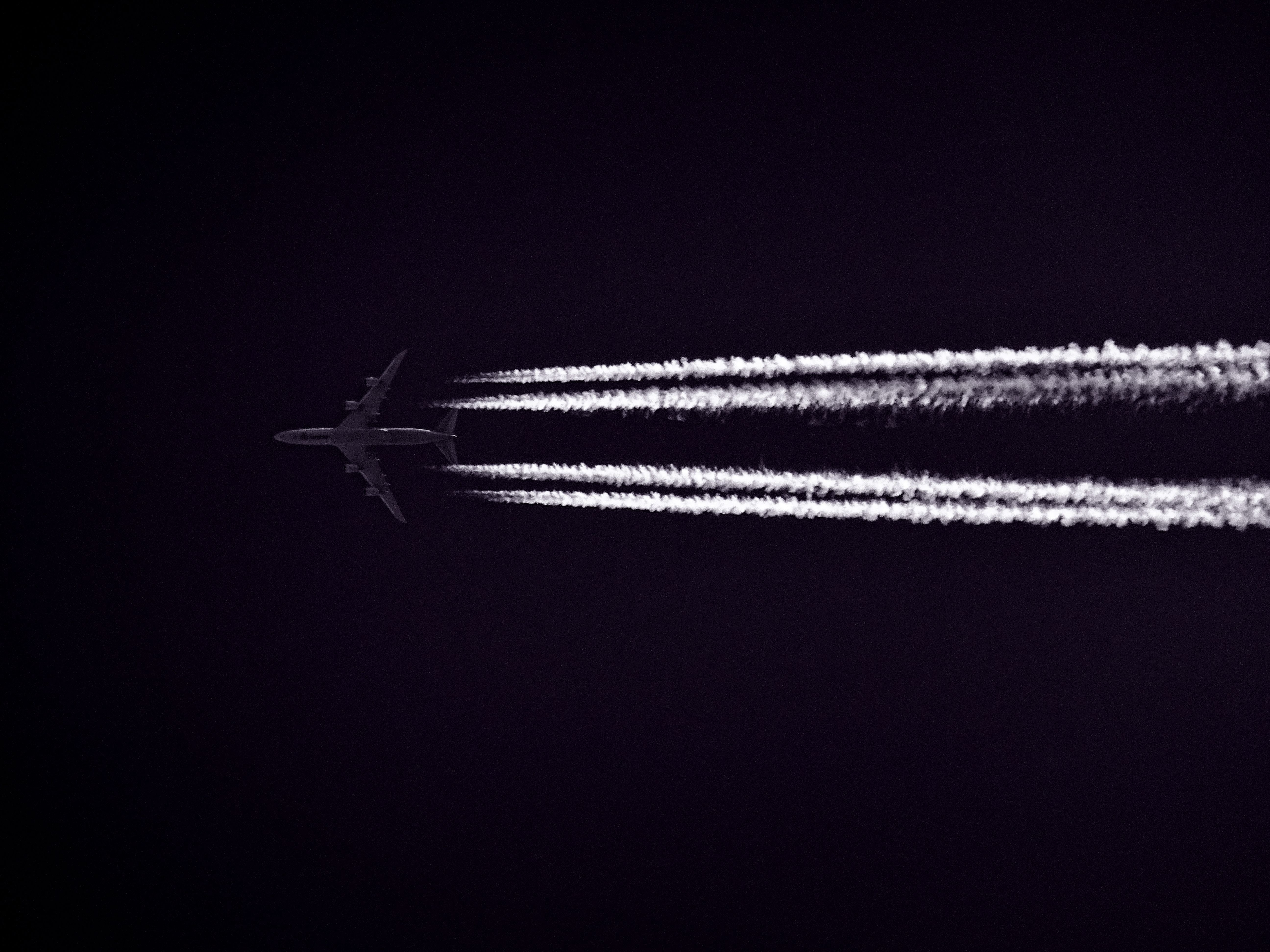 Photo Of Airplane Across The Clouds During Night Time 3900 5184x3888