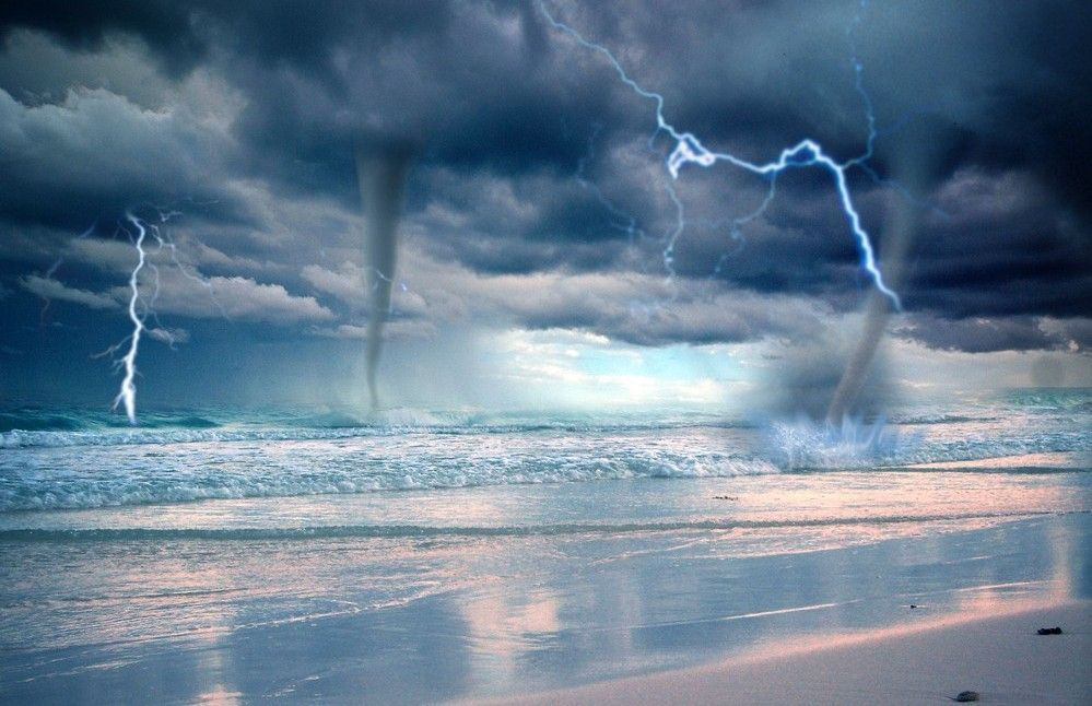 Storm Over Water beach lightning ocean storm waterspouts 999x646