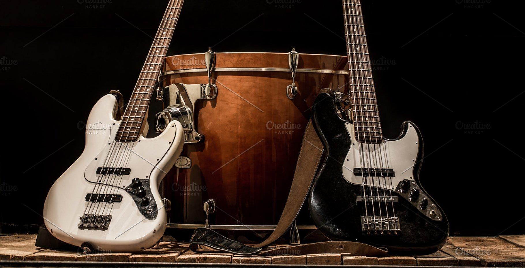musical instruments drum bass Bochka bass guitar on a black 1820x928