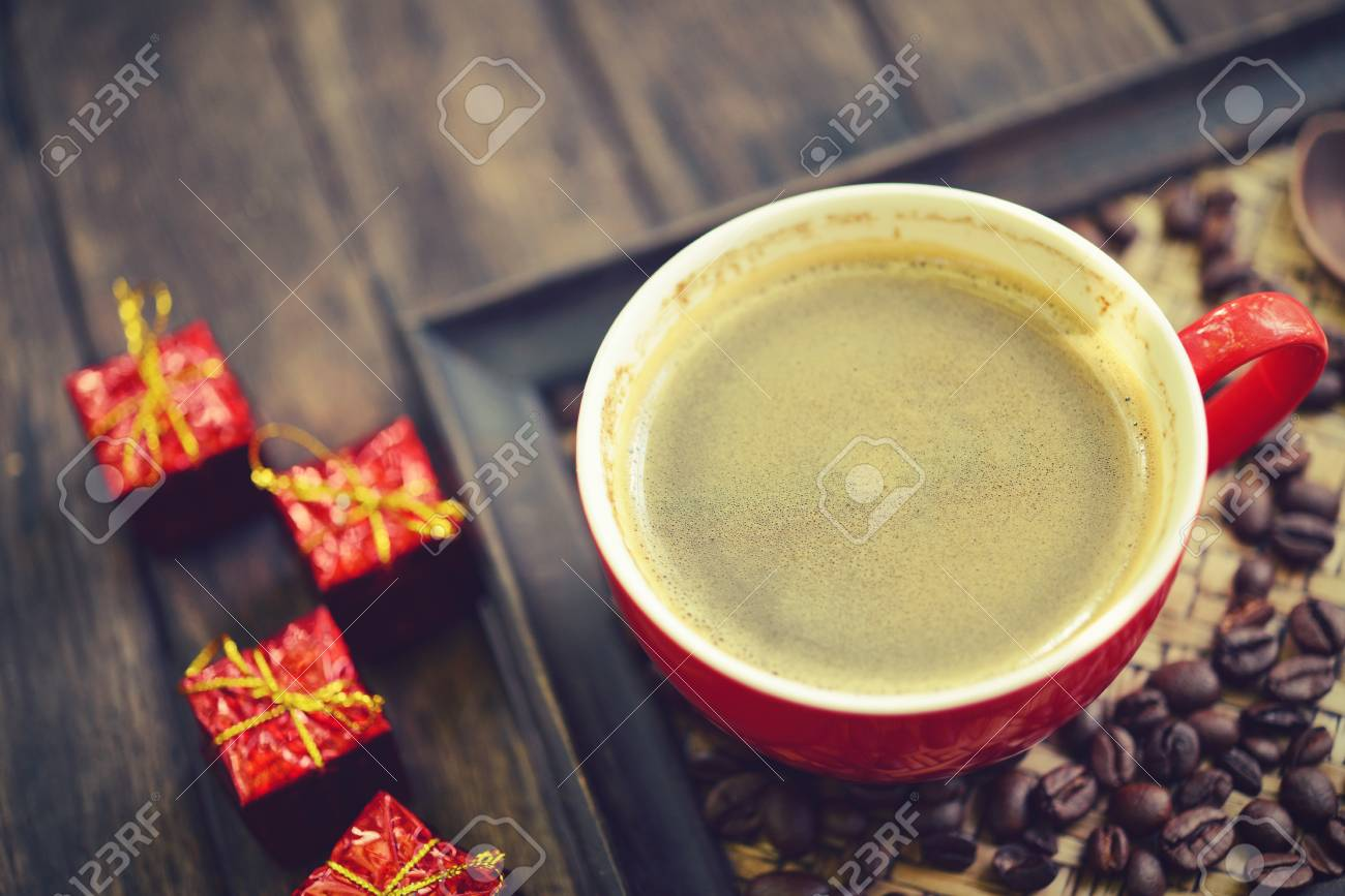 Coffee Cup And Christmas Redbox Decoration On Wooden Table 1300x867