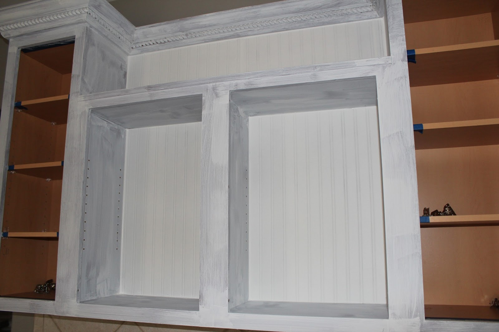 While I worked on the cabinet doors the hubs primed the cabinets 1600x1066