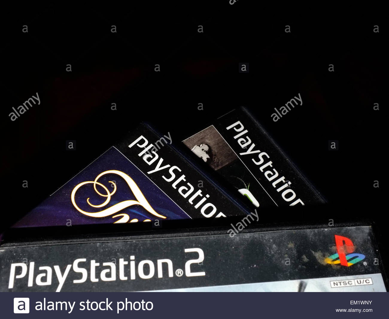 A pile of Playstation 2 games photographed against a black Stock 1300x1065