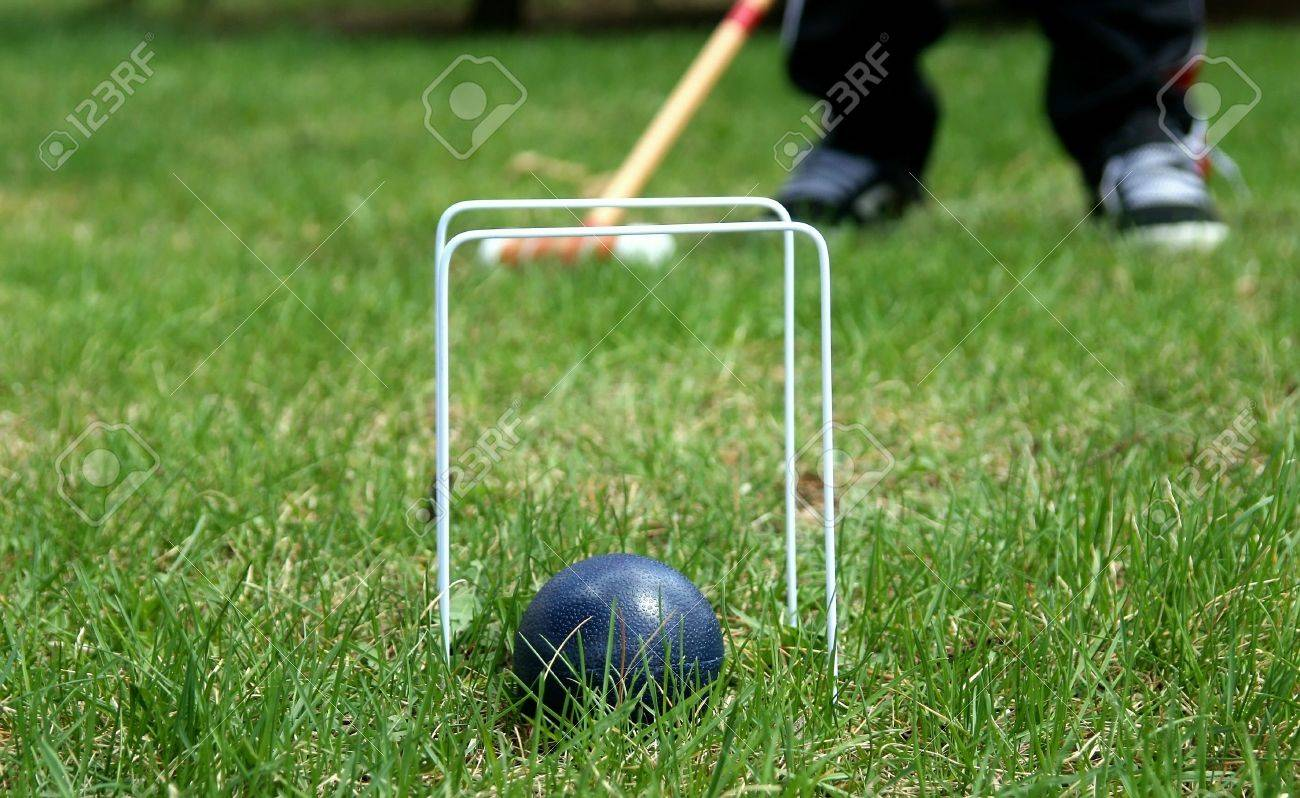 Croquet Ball And Hoops With Mallet In Background Stock Photo 1300x798