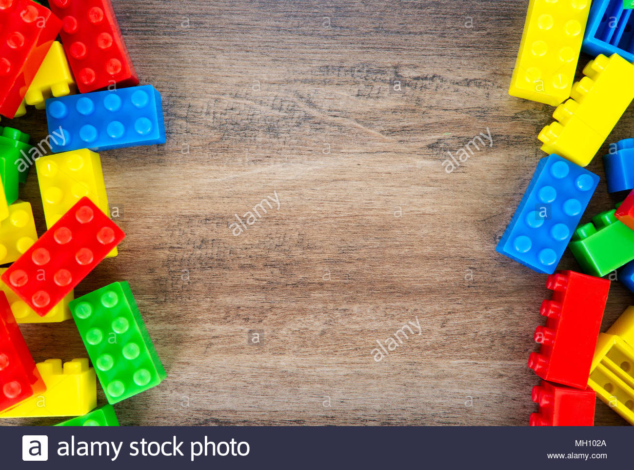 Colorful toy building blocks on wood background Stock Photo   Alamy 1300x963